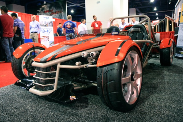 Exomotive and Dove Racing Enterprises exhibit the MEV Rocket at SEMA 2011